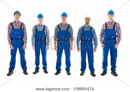 Portrait Of Confident Male Carpenters Standing In Row