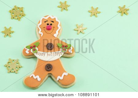 Gingerbread Cookie With Stars On Blue Background