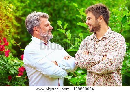 Portrait Of Happy Father And Son, That Are Similar In Appearance
