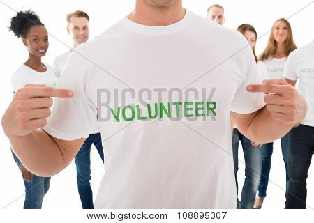 Happy Man Showing Volunteer Text On Tshirt