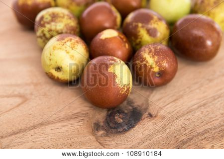Close up of china dates on wooden plank poster