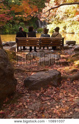 Four Japanese People Enjoying An Autumnal Scene