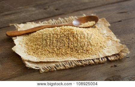 Pile of whole wheat CousCous with a spoon poster