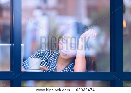 Asia Woman Sitting At Bar Table On Relax Day