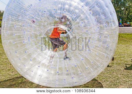 Children Have Fun In The Zorbing Ball