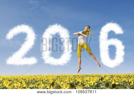 Woman Dancing At Sunflower Garden With Numbers 2016