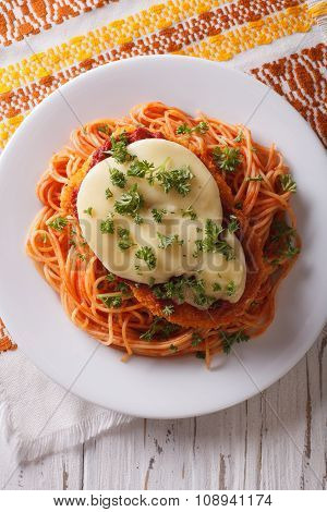 Italian Chicken Parmigiana And Pasta Close Up. Vertical Top View