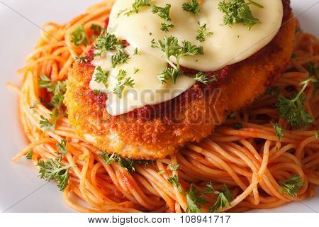 Chicken Parmigiana And Spaghetti Close-up On A Plate. Horizontal
