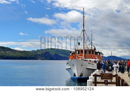 Tourists Boat At The Pier In Lake Nahuel Huapi