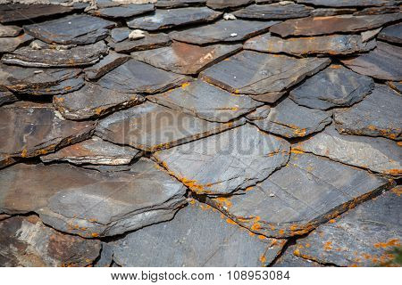 Schist Roof Tiles With Lichen in the mountains