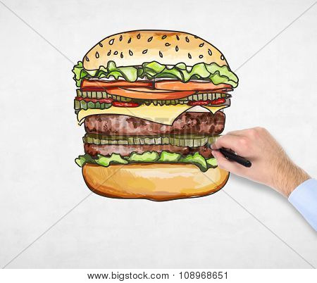 A Man's Hand Is Drawing A Colourful Burger. A Concept Of Fast Food. A Concrete Background.