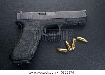 Pistol gun on black background