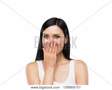 A Portrait Of A Happy Brunette Lady In A White Tank Top Who Is Covering Her Mouth By The Hand. Isola
