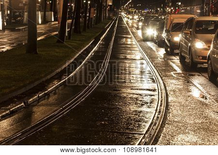 Wet Trolley Rails In The Light And Streets Are Reflecting Light
