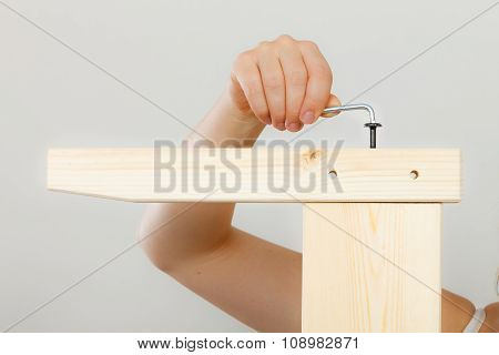 Assembling Wooden Furniture Using Scredriver. Diy.