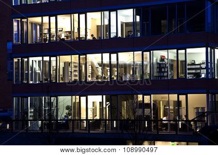 HAMBURG, GERMANY - APRIL 4, 2011: facade in historic Speicherstadt at night in Hamburg. The hafencity is a new building projekt in the old part of the speicherstadt and houses offices and apartments.