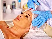 Woman middle-aged in spa salon with beautician. Beauty woman giving botox injections. Medicine and beauty. poster
