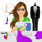 attractive young fashion designer dressmaker woman using sewing machine to sew a purple tissue poster