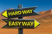 Hard Way Easy Way signpost in a desert background poster