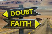 Doubt - Faith signpost in a desert road on background poster