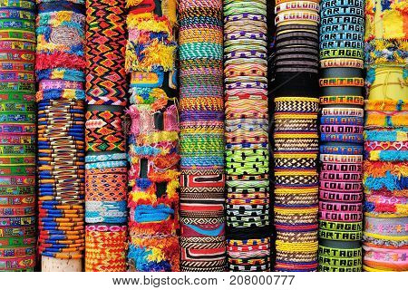 Street stall with hand-made souvenirs band to the hand from Cartageny Colombia South America