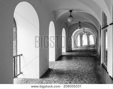 Old historical arcade at Little Square in Old Town, Prague, Czech Republic. Black and white image.