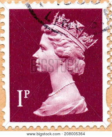UKRAINE - CIRCA 2017: A postage stamp printed in England shows Portrait of Queen Elizabeth 2nd circa 1998