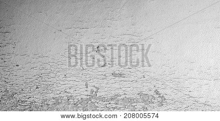 Vintage wall texture background. Old uneven surface