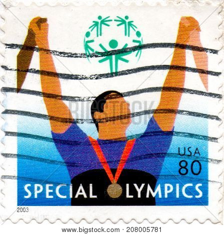 Ukraine - circa 2017: A postage stamp printed in USA shows athlete and an inscription Special Olympics circa 2003