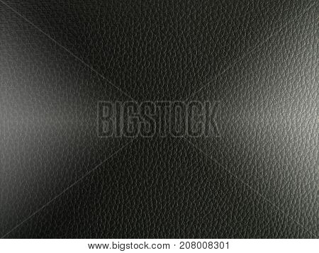 Luxury black leather texture with light for background.