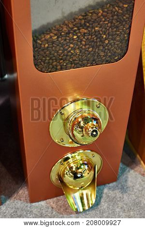 The wooden coffee dispenser with bean closeup