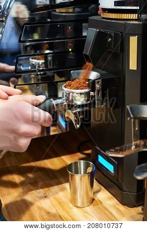 Barista Pours Ground Coffee Into Holder