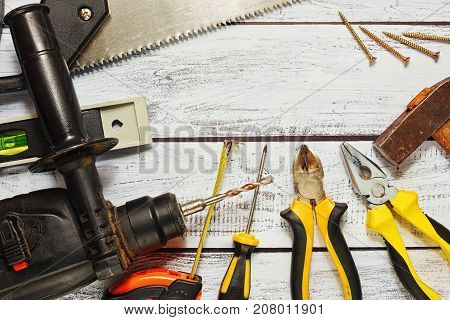 Different Working Tools On Wooden Background