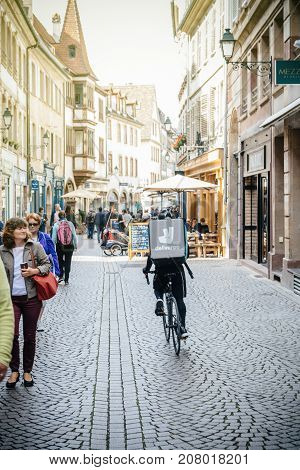 STRASBOURG FRANCE - OCT 1 2017: Deliveroo delivery bike in French city cycling fast for food delivery on time