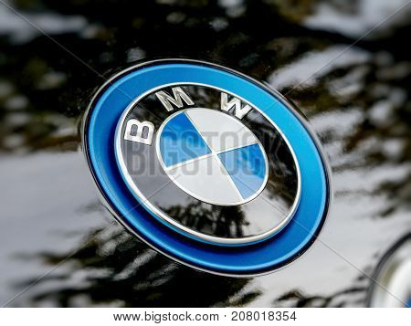 STRASBOURG FRANCE - MAY 30 2017: Side view of blue BMW logotype on the electric i1 limousine