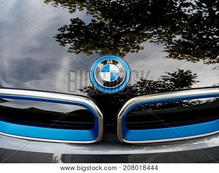 STRASBOURG FRANCE - MAY 30 2017: Front view of blue BMW logotype on the electric i1 limousine