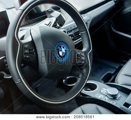 STRASBOURG FRANCE - MAY 30 2017: Steering wheel of BMW electric car with logotype of the German car maker