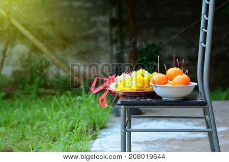 Belief in worship the pay respect ceremony with bunch of flowers and fruits