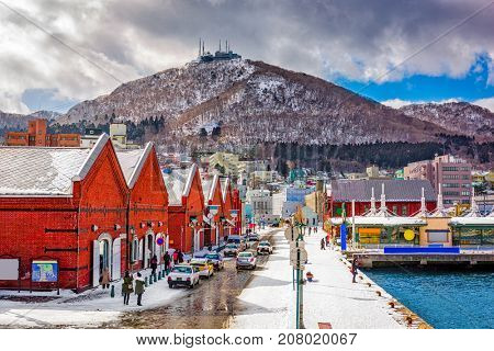 Hakodate, Japan cityscape at the historic Red Brick Warehouses and Mt. Hakodate.