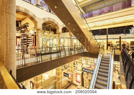 AMSTERDAM NETHERLANDS - JUNE 21 2016: Interior of the Magna Plaza with escalators and stores. Amsterdam Netherlands.