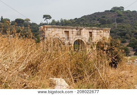 The Triumphal Arch of Metius Modestus welcomes visitors at the entrance to the Patara site, Turkey