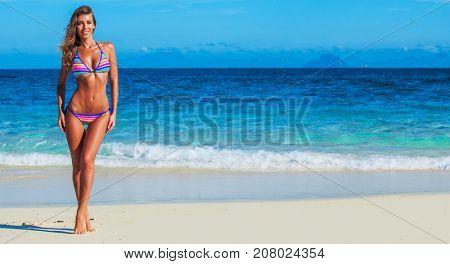 Pretty slim girl at tropical sea beach