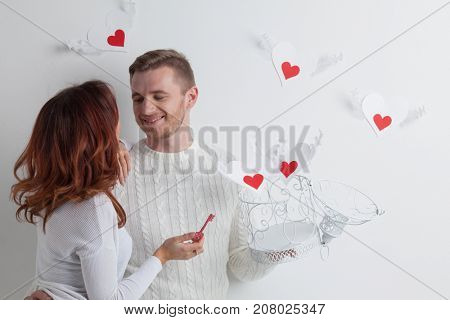 Couple releasing love, man and woman open cage with winged hearts, valentines day concept