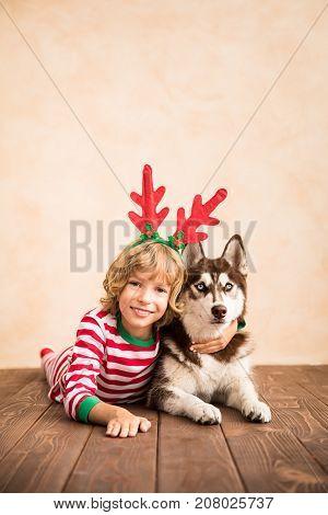 Happy Child And Dog On Christmas Eve