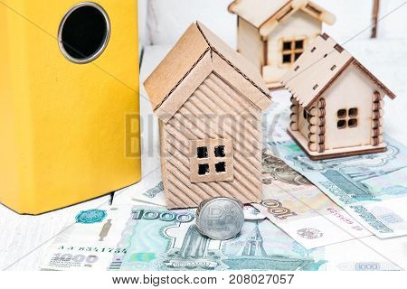 Russian money and different houses. Ruble mortgage. Russia