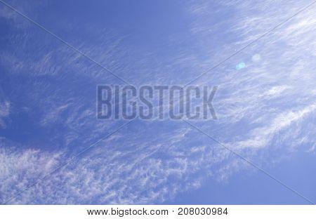 cumulus white clouds against a beautiful blue sky, bizarre patterns
