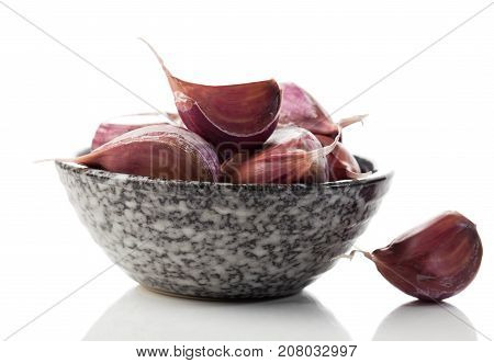 cloves of garlic on a white background