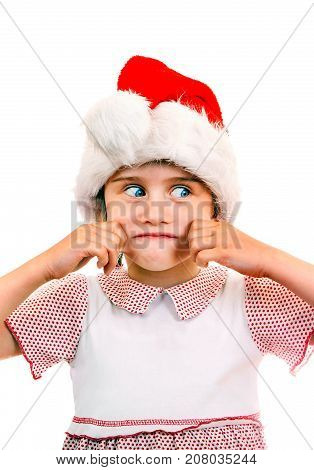 Small Girl in Santa Hat try to make a smile on the White