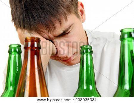 Sad and Tired Young Man in Alcohol Addiction on the White