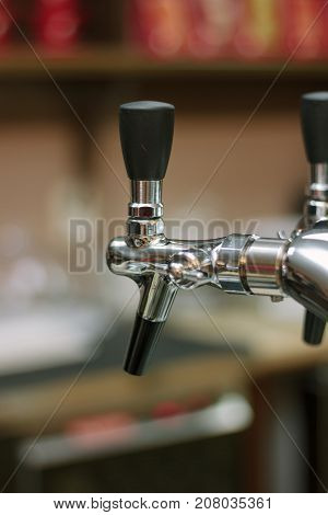 Beer faucet on bar ready to fuel a beer